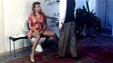 Anita Rinaldi giving a professional blowjob while peeing