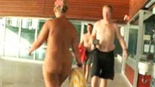 Exhibitionist woman walking around the public swimming pool