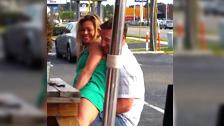 A guy masturbates his gf at a terrace in public