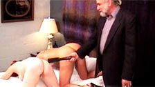 Two women subjugated by a sadistic old man in a room