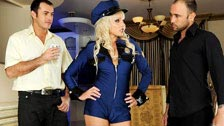 The policewoman Alexandra Cat brings two men under an effective control