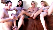 Foot fetishist goes crazy with three mature Sluts