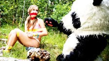 Penny Wild fucks with a panda bear who frees her from her captivity