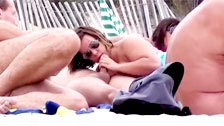 A group of mature exhibitionists and nudists having sex on the beach