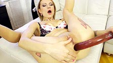 Lana Roberts fucks her ass with a huge double dildo