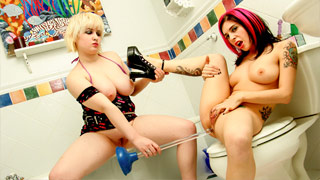 Joanna Angel having a lesbian encounter with the hot Sinead in the bathroom