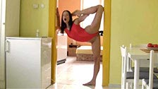 A gymnast masturbates in impossible postures with a dildo