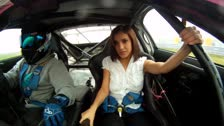 Busty hot chick, copilot in a racing car